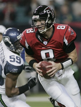 Atlanta Falcons quarterback Chris Redman, right, eludes Seattle Seahawks linebacker Julian Peterson during the first quarter of their game, played Sunday afternoon.  Atlanta held off Seattle 44-41.
